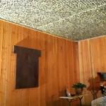 Aménagement patio, murs bois, filet de camouflage